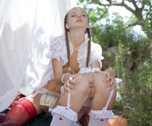 Skinny teen girls Milena D & Nika N in pigtails kiss & eat pussy outdoors