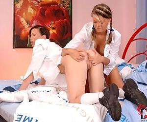 Young lesbians Trisha and Sophei remove school uniforms while having sex