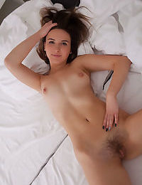 Pretty brunette Anata undressing for bed flashes spread pussy closeup