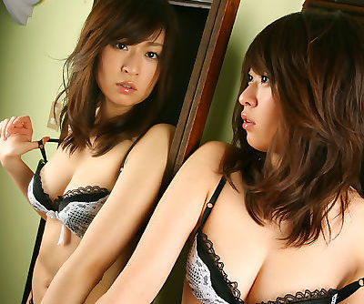 Petite asian coed with neat ass Risa Misaki slipping off her lingerie