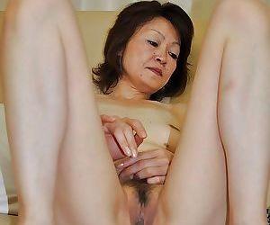 Bashful grown up asian lady Takako Kumagaya undressing and spreading will not hear of legs