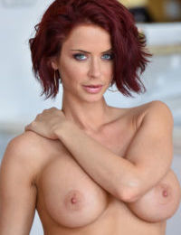 Mature sexy redhead Emily flaunts her prized big tits in the kitchen & garden