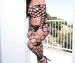 Top Asian pornstar Cindy Starfall models on condo balcony in sexy hosiery