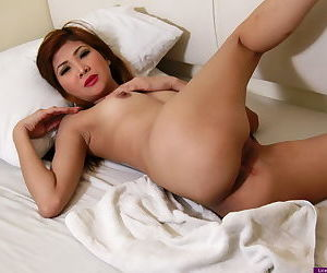 Young Asian girl slips off satin lingerie to model in the nude for first time