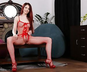 Young Euro redhead Lovenia Lux stretches cunt lips after removing bodystocking