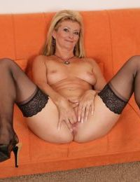 Older blonde woman Diana gets off on fingering herself to orgasm in stockings