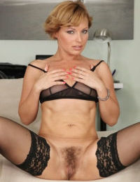 Short haired aged lady Szilvia Lauren parts her hairy cunt lips in home office