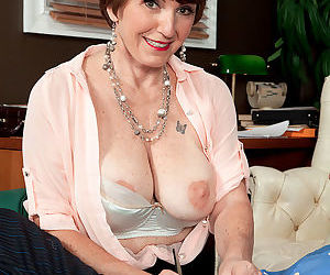 Mature lady Bea Cummins whips out her big boobs while seducing a younger guy