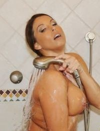 Mature MILF Stacie Starr wets her big natural tits and ass under shower spray