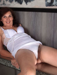 Mature woman Francesca tugs on her labia lips to show the inside of her beaver