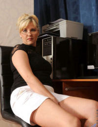 Mature woman hikes up her skirt to masturbate in her home office