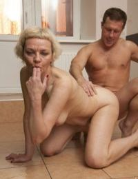 Old mature chick Madlen gets some young cock in her horny twat in the kitchen