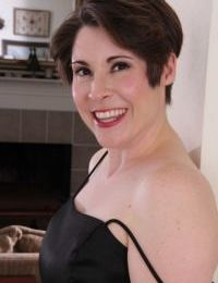 Short haired older lady Sadie Jones undressing for masturbation session