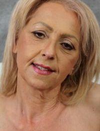 Older lady Shiela parts her hairy bush before fervently masturbating