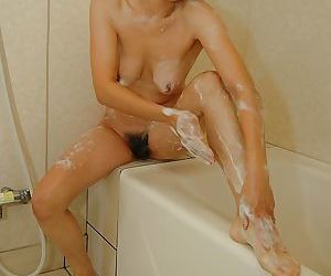Asian MILF Takako Yanase taking shower together with exposing their way shaggy cunt