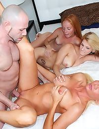 Three lovely babes invite a big dick bald guy for a perfect foursome