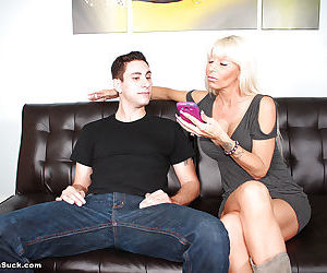 Mom blonde is getting a juicy young wiener deep in her mouth