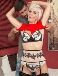 Over 50 lady Nicol Mandorla stripped by young stud for sex romp in bedroom