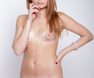 Young Linessa shows no emotion as she reveals her young naked body for ogling
