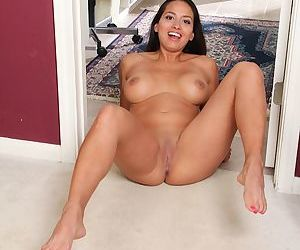 Latina solo girl Abby Melon unveiling large MILF tits and shaved vagina