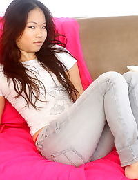 Pretty Asian amateur chick Grace gets topless in tight jeans
