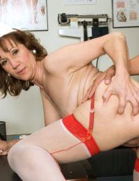 Older nurse Elle Denay introduces a young boy to the joys of anal sex