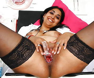 Aged Indian woman Alice using a speculum on her pussy in hospital