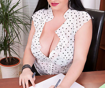 Hot MILF secretary Juliana Simms lifts mini skirt and bares big tits in office