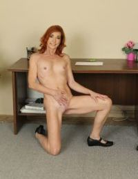 Office mature lady Ariel reveals her ass while spreading her legs