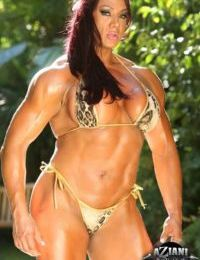 Aged female bodybuilder Amber Deluca gets around to exposing her clit on patio