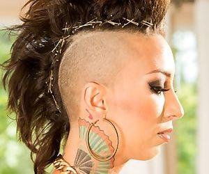 Solo model Bella Bellz flaunts her tattooed ass with hair in a mohawk cut
