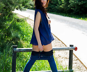 Brunette teen Evita Lima shows off her big natural tits on the road