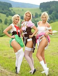 Blonde girls in costumes and pigtails lick pussy in hot outdoor threesome