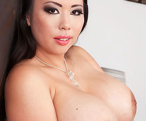 Asian plumper Tigerr Benson bares her huge tits before toying her pierced twat
