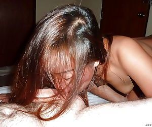 Tiny Asian hooker taking cumshot on phat ass after fucking a Farang