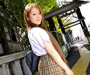 Innocent Japanese schoolgirl Ria Sakurai flashes downcast wan Y-fronts on touching release