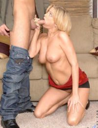 Middle-aged blonde broad hikes up her miniskirt for oral sex before fucking