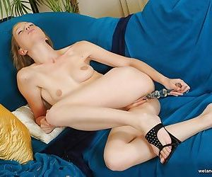 Young solo girl Dasha stimulating puffy vagina with sex toy on sofa