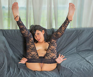 Hot young Dana Vega strips off her lace body stocking to masturbate solo