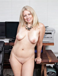 Hot mature blonde woman Zoey Tyler flashing pantyhose covered ass cheeks