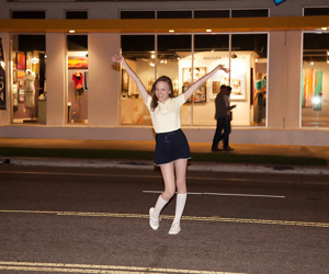 Diet dark hair juvenile Audrey Star posing in a skimpy short skirt outdoors