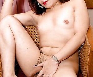Asian tranny Num letting small tits fall free from bra before masturbating