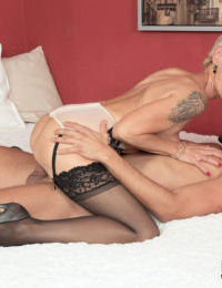 Horny mature woman Nicol Mandorla banging younger lover in stockings