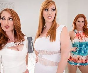 Redhead housewives finish a lesbian threesome by grinding pussies together