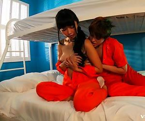 Jailbirds Marica Hase & Lily Cade enjoy a clandestine lesbian kiss and grope