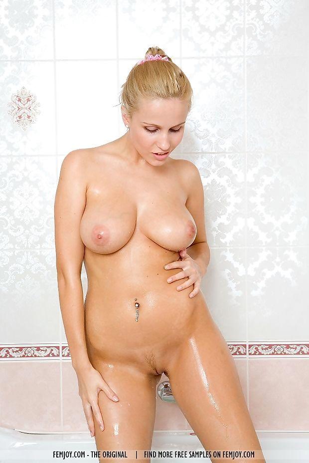 Christa- blonde- nude- bath tub- water- wet