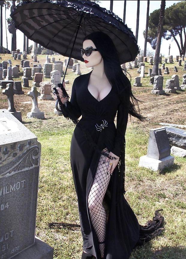 Slutty goth bimbo at a graveyard