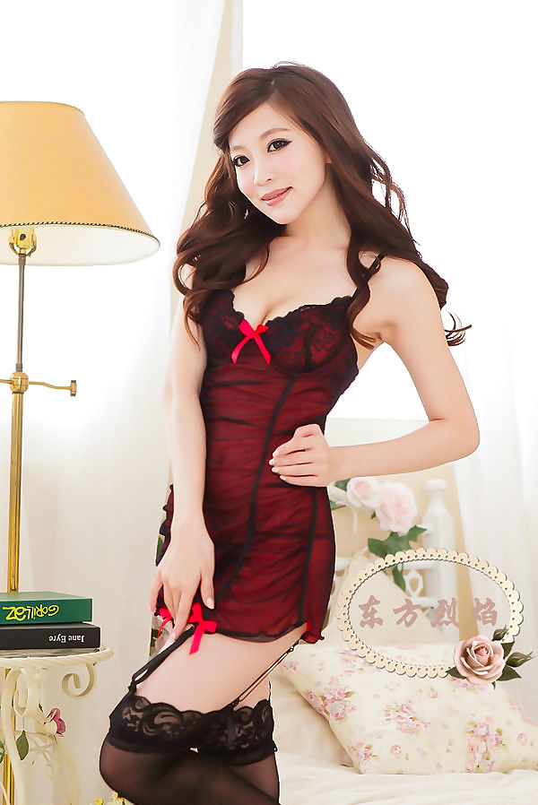 Pretty asian woman in a red babydoll nightgown
