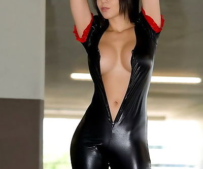 Her lusty latex outfit fits like a glove and is bound to arouse