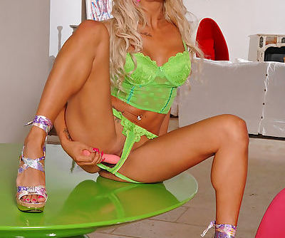 Smoking hot and winning doll in green panties likes to insert huge sex tool in her shaved pussy